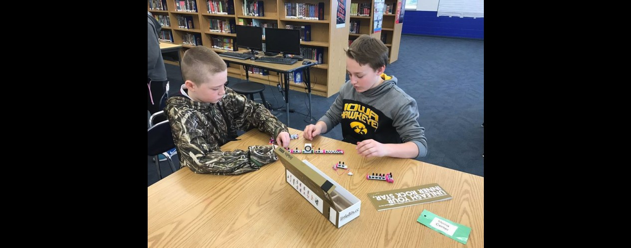 Photograph of middle school students using the MS Makerspace