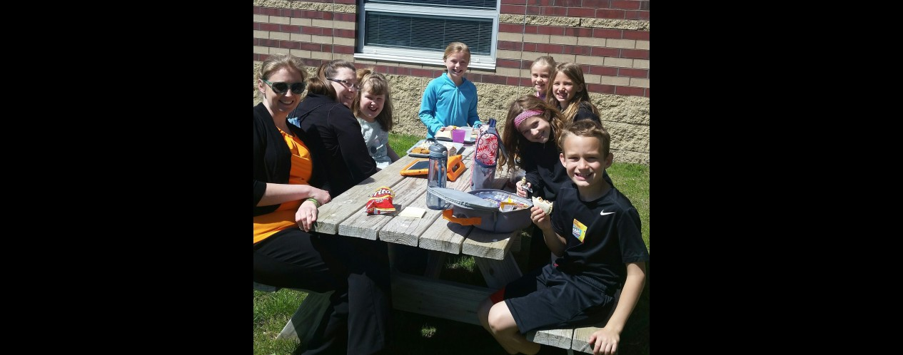 Photograph of students having lunch with Mrs. Anderson