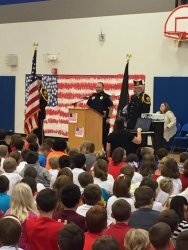 Photo of Officer Kasel presenting at Elementary School Veterans Day program